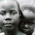 Young Girl With Her Younger Brother Africa